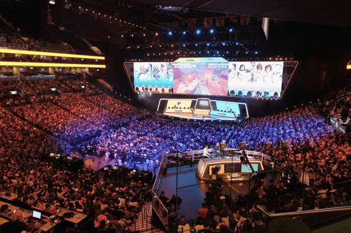 A large crowd packed in an arena to watch Overwatch League.